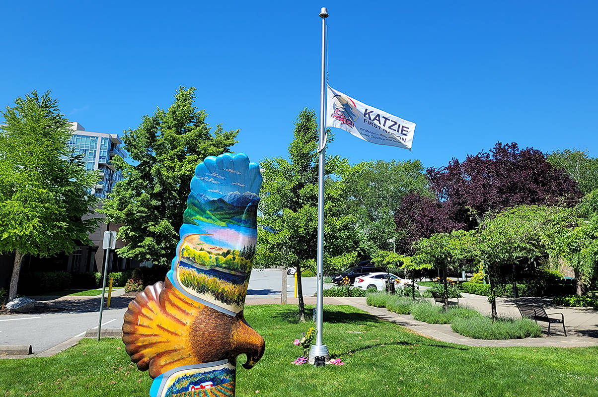 Members of the public are invited to lay shoes, flowers and other memorial items at the Katzie First Nation Flag in Spirit Square, next to Pitt Meadows City Hall. (Neil Corbett/The News)