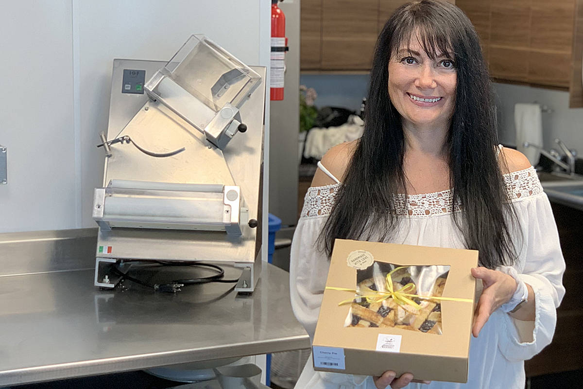 Dale Cull has partnered with Langley's Maritime Seafoods to bake and sell Father's Day pies to benefit cancer research. One of the most popular is her cherry pie, boxed and wrapped with a yellow ribbon. (Special to Langley Advance Times)