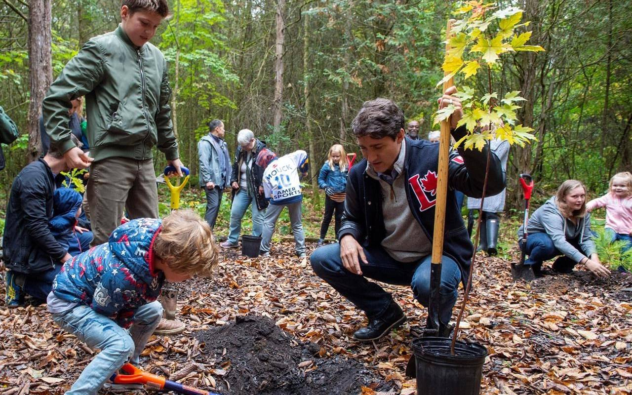 Prime Minister Justin Trudeau plants a tree with his sons Hadrien and Xavier at the Frank Conservation Area in Plainfield, Ont. on Sunday, October 6, 2019. THE CANADIAN PRESS/Frank Gunn