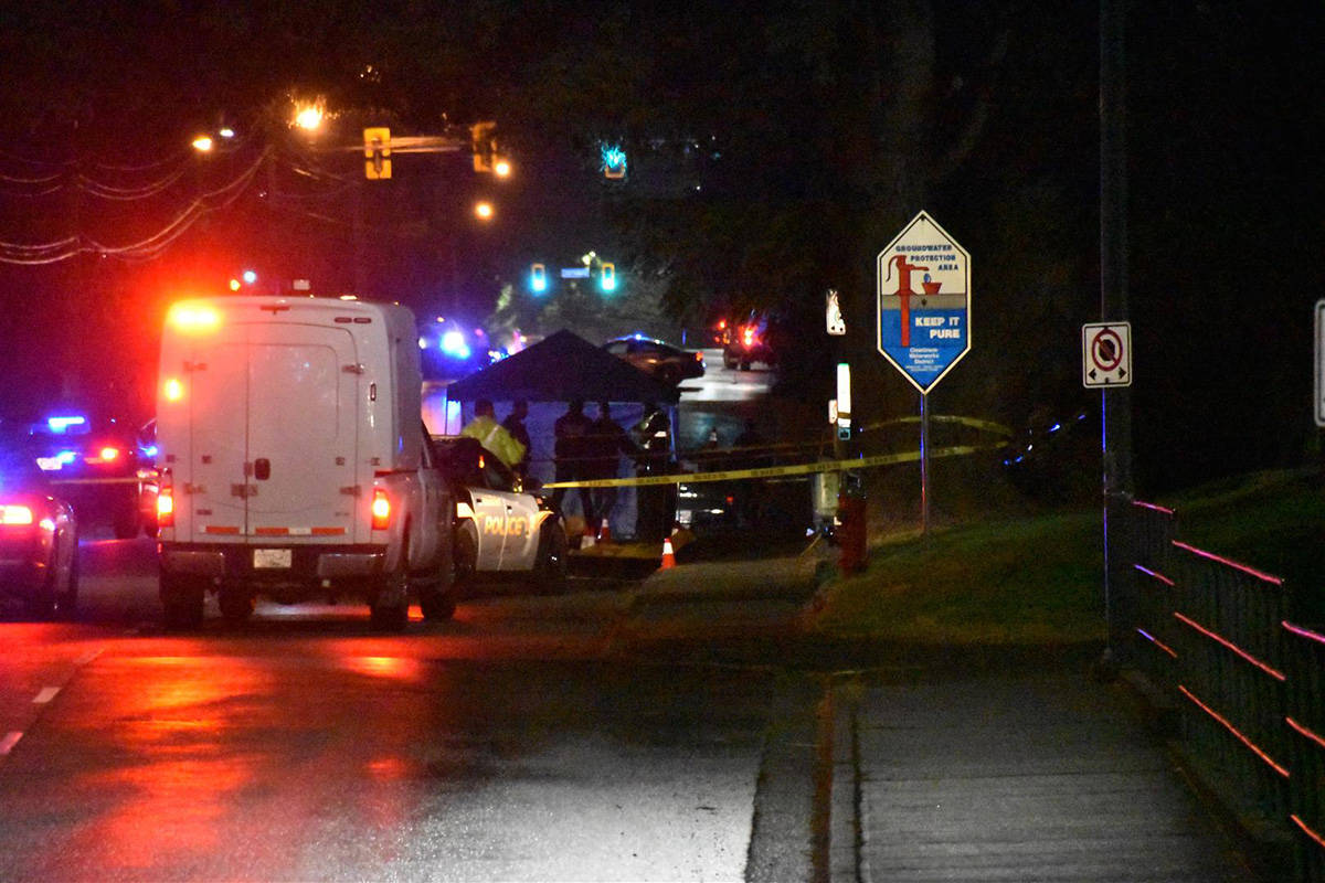 A truck was stopped several dozen meters past the impact site, and police covered parts of it to preserve evidence from the rain, a source said. (Curtis Kreklau/South Fraser News Services)