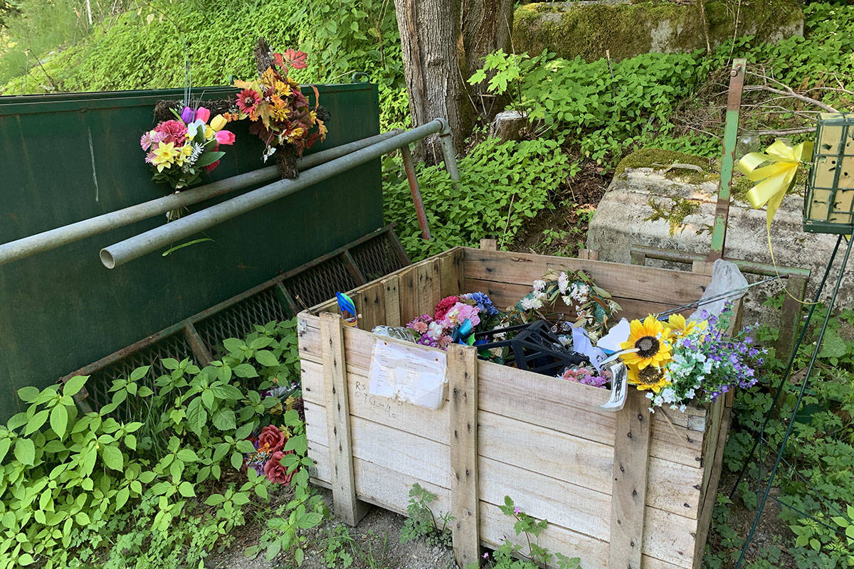 Flowers and other adornments left at Hope Cemetery have been moved off to a back storage and maintenance area. (Jessica Peters/ Hope Standard)