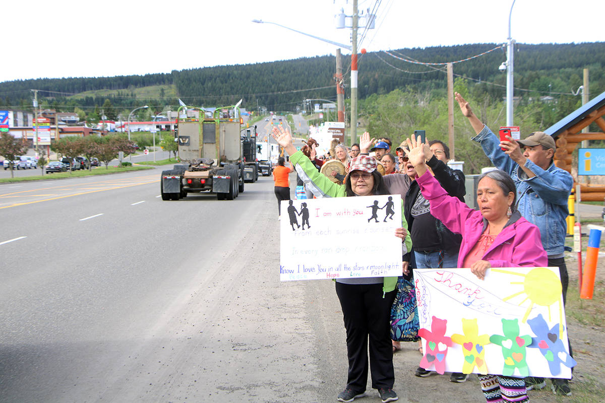 Members of the Canim Lake Band and 100 Mile House community welcome a convoy of trucks passing through town on the way to the Kamloops Residental School. (Patrick Davies photo - 100 Mile Free Press)