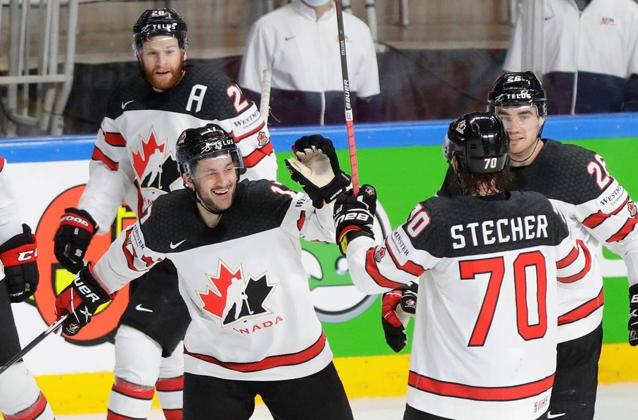 Canada's Justin Danforth, second left, celebrates with teammates after scoring his side's fourth goal during the Ice Hockey World Championship semifinal match between the United States and Canada at the Arena in Riga, Latvia, Saturday, June 5, 2021. THE CANADIAN PRESS/AP-Sergei Grits