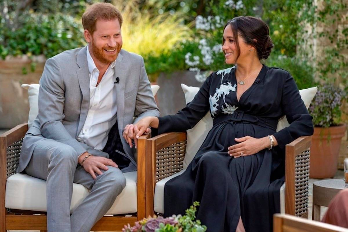 """FILE – This image provided by Harpo Productions shows Prince Harry, left, and Meghan, Duchess of Sussex, speaking about expecting their second child during an interview with Oprah Winfrey. """"Oprah with Meghan and Harry: A CBS Primetime Special"""" airs March 7 as a two-hour exclusive primetime special on the CBS Television Network. (Joe Pugliese/Harpo Productions via AP)"""