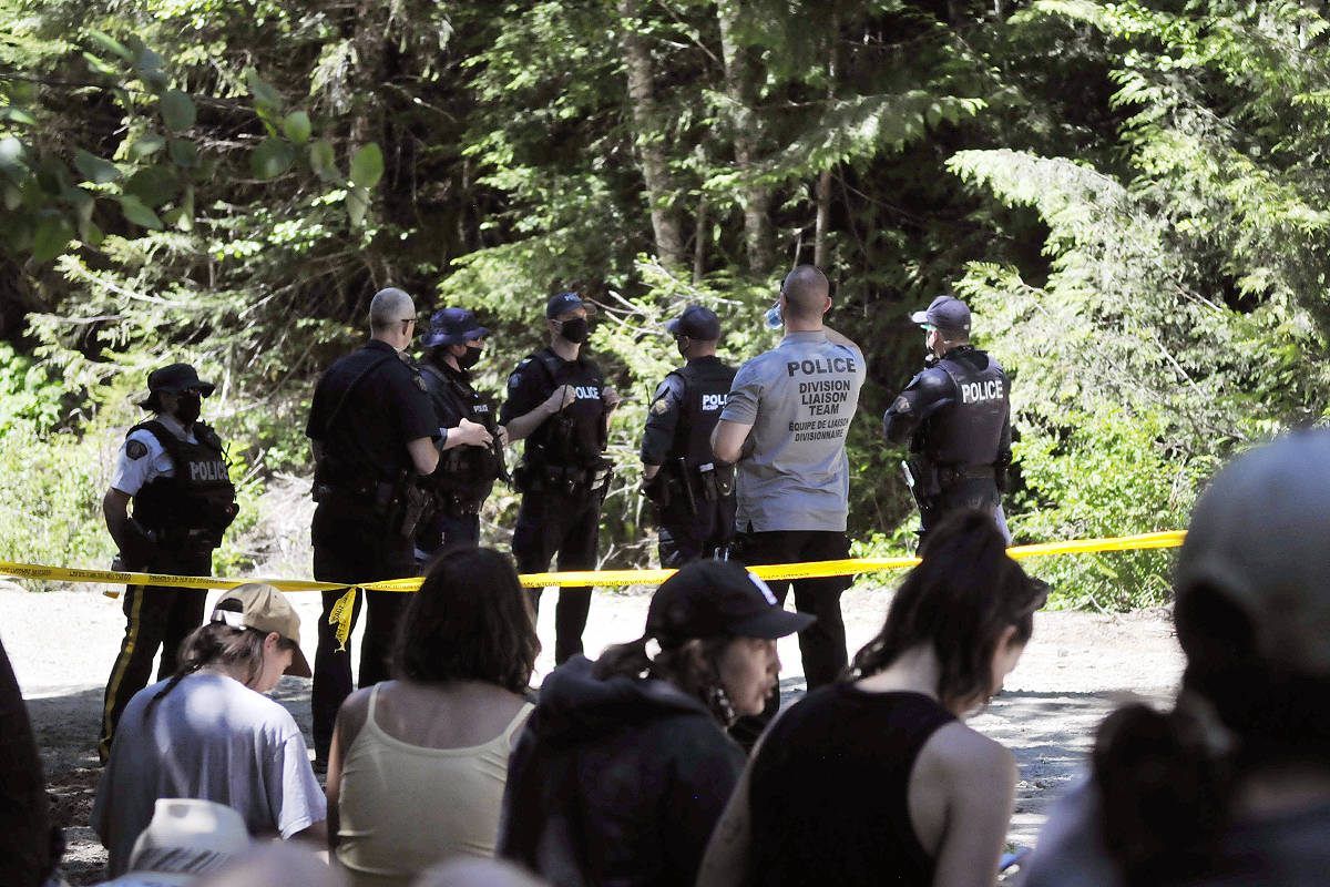 Police establish a presence at Waterfall camp in the Fairy Creek area late last month during enforcement of the BC Supreme Court injunction prohibiting blockades on Tree Farm Licence 46 (Zoe Ducklow/Black Press Media)