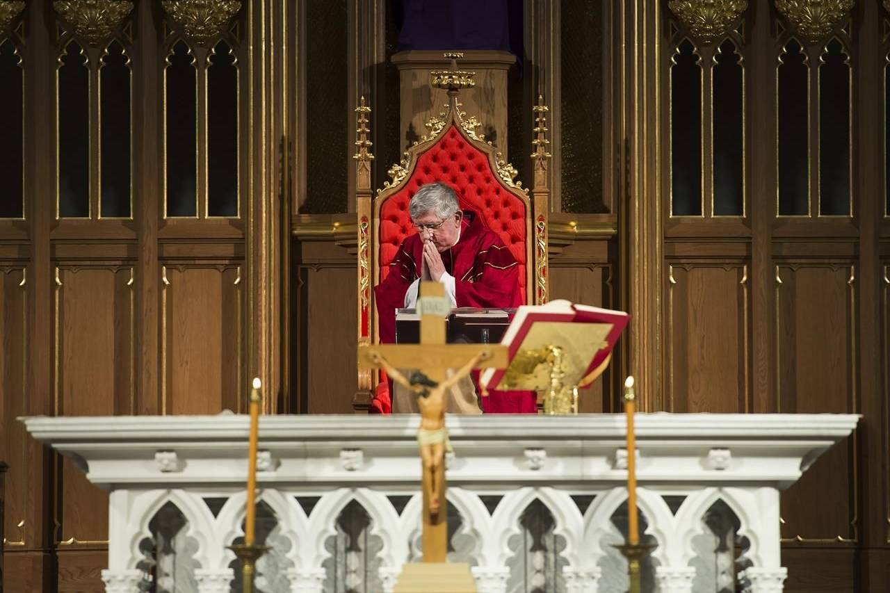 Cardinal Thomas Collins delivers at online Good Friday service in an empty St. Michael's Cathedral in Toronto on April 10, 2020. THE CANADIAN PRESS/Nathan Denette