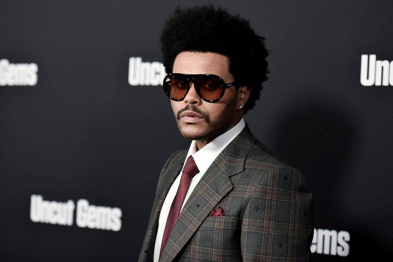 """The Weeknd attends the LA premiere of """"Uncut Gems"""" at ArcLight Hollywood in Los Angeles on December 11, 2019. Justin Bieber and the Weeknd could be taking home some serious hardware at tonight's Juno Awards. THE CANADIAN PRESS/AP, Invision, Richard Shotwell"""