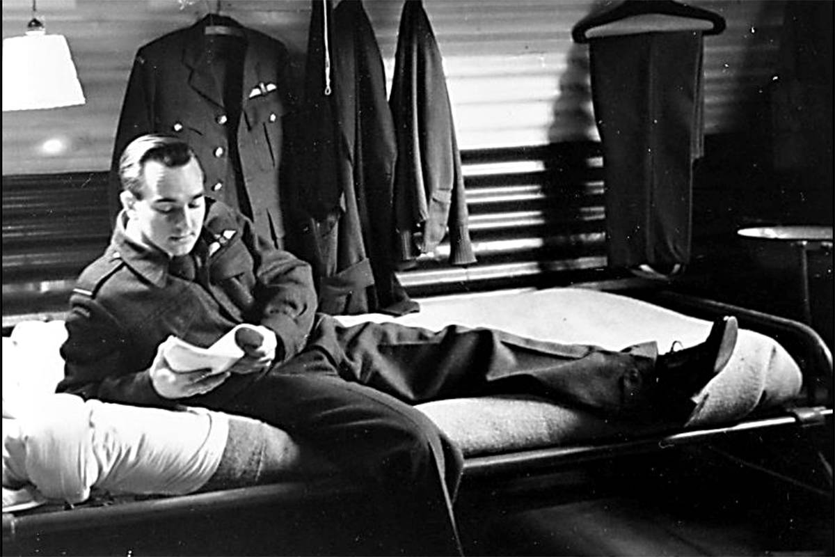 In early 1944, Flying Officer Jack Logan rests on his bunk in crew accommodations. He was later promoted to Flight Lieutenant as he piloted RCAF 422 Squadron Sunderland flying boats. (Logan collection/special to Langley Advance Times)