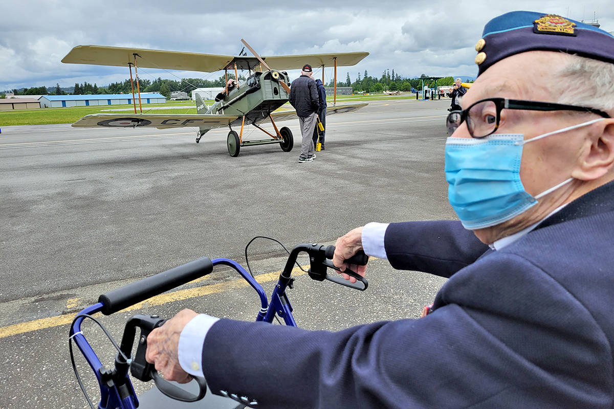 D-day pilot Jack Logan celebrated his 100th birthday at the Langley Museum of Flight, which put its SE5A replace into the air for a fly-past. (Dan Ferguson/Langley Advance Times)