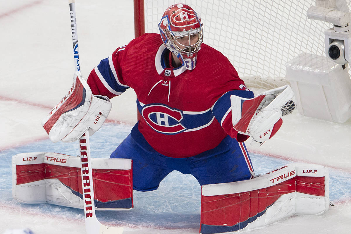 Montreal Canadiens goaltender Carey Price (31) makes a glove save during first period NHL Stanley Cup playoff hockey action against the Winnipeg Jets, in Montreal, Sunday, June 6, 2021. THE CANADIAN PRESS/Ryan Remiorz