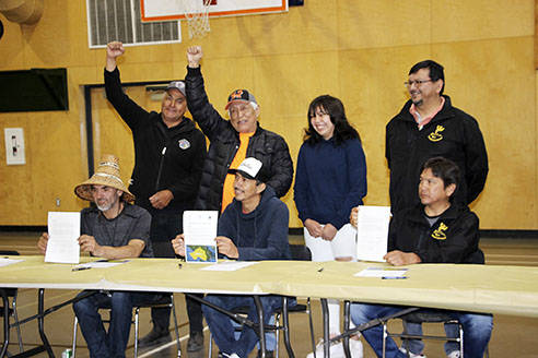 Leaders of the Huy-ay-aht, Pacheedaht and Ditidaht First Nations sign an declaration to take back power over the resources on their traditional territories. The agreement includes telling the provincial government to stop old-growth logging for two years. (Huu-ay-aht First Nation photo)