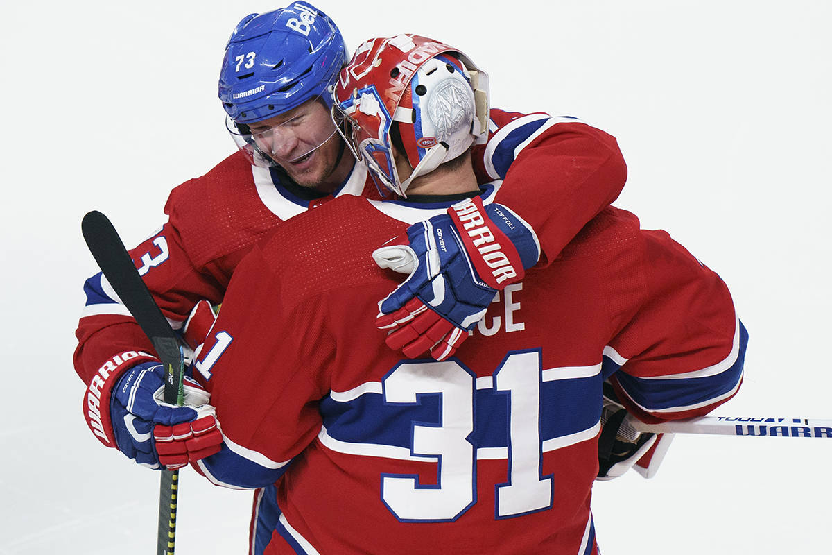 Montreal Canadiens' Tyler Toffoli celebrates his game-winning goal with teammate Carey Price following overtime NHL Stanley Cup playoff hockey action against the Winnipeg Jets, in Montreal, Monday, June 7, 2021. THE CANADIAN PRESS/Paul Chiasson