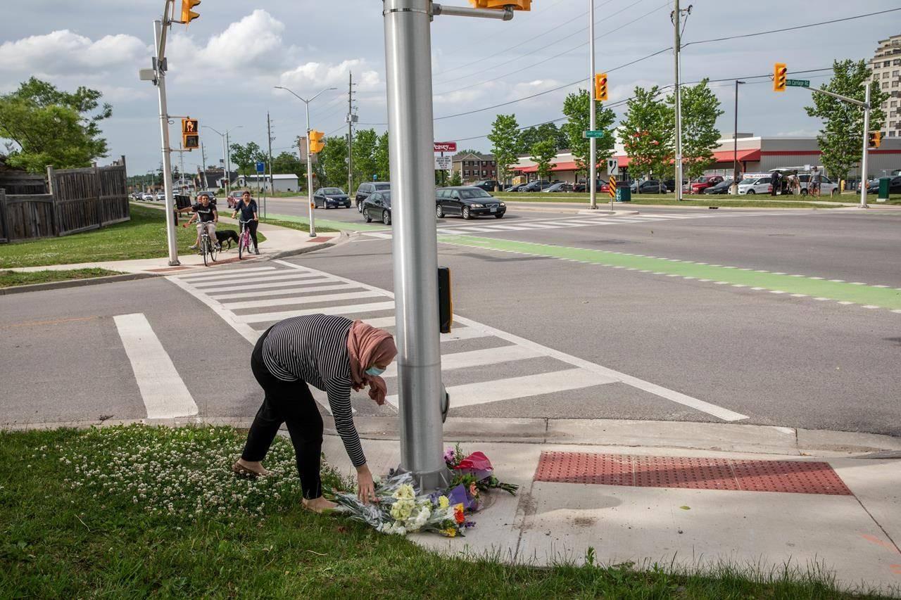 People show up to the location where a family of five was hit by a driver, in London, Ont., Monday, June 7, 2021. Four of the members of the family died and one is in critical condition. A 20 year old male has been charged with four counts of first degree murder and count of attempted murder in connection with the crime. THE CANADIAN PRESS/Brett Gundlock