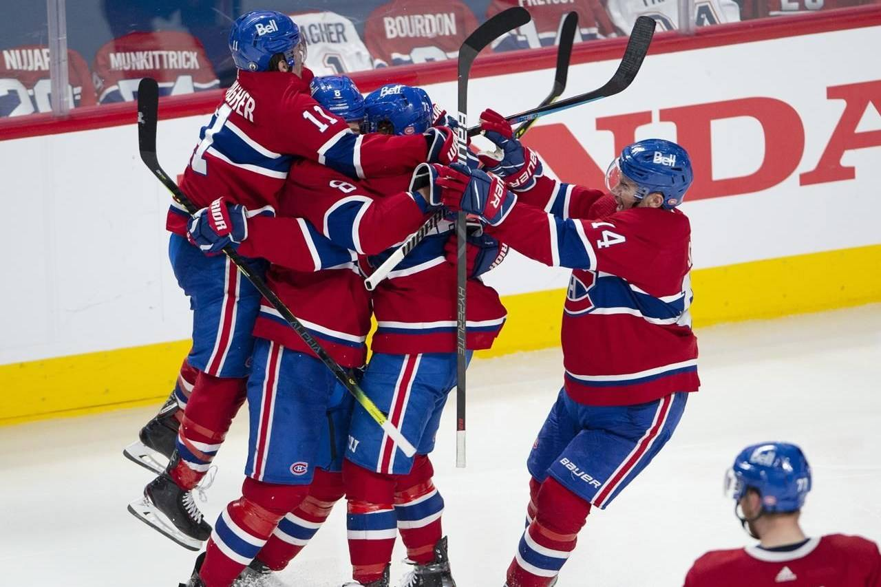 Montreal Canadiens' Tyler Toffoli celebrates with teammates after scoring the winning goal following overtime NHL Stanley Cup playoff hockey action against the Winnipeg Jets, in Montreal, Monday, June 7, 2021. THE CANADIAN PRESS/Paul Chiasson Montreal Canadiens' Tyler Toffoli celebrates with teammates after scoring the winning goal following overtime NHL Stanley Cup playoff hockey action against the Winnipeg Jets, in Montreal, Monday, June 7, 2021. THE CANADIAN PRESS/Paul Chiasson