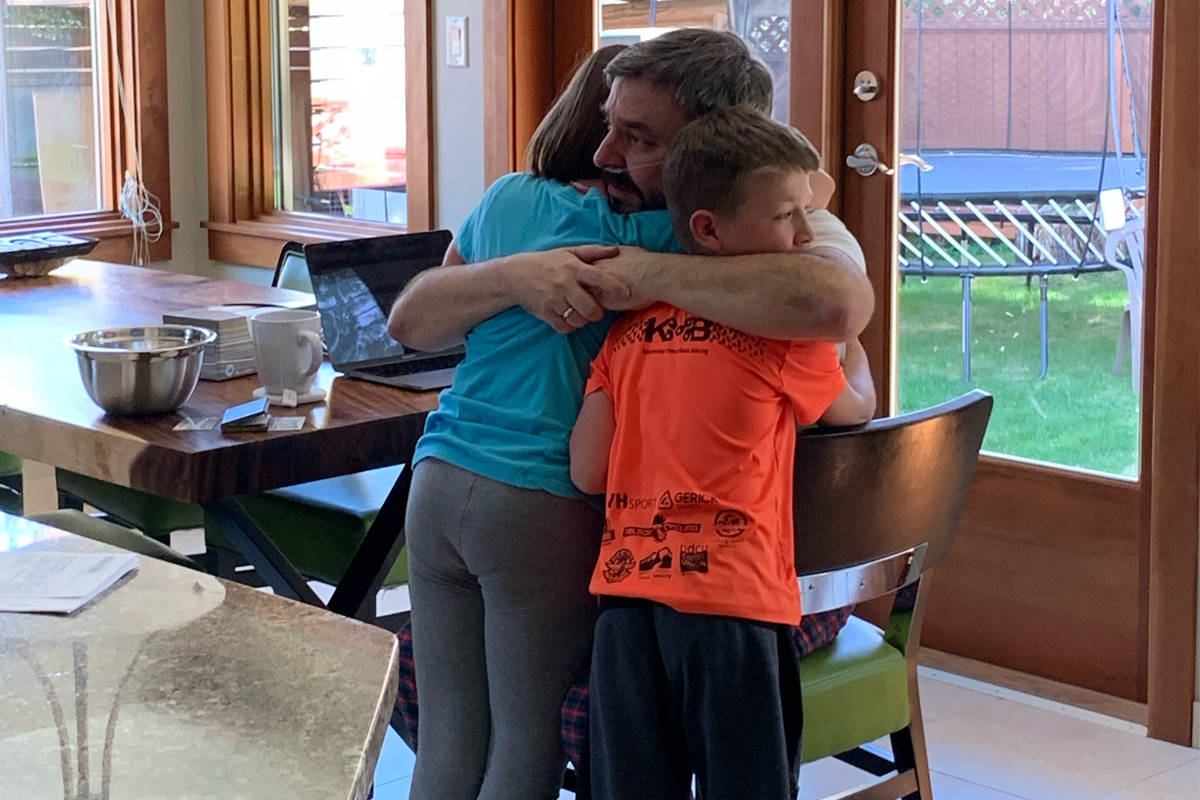 Kristina Little took this photo of the moment her children first saw their father Rob after he returned home from hospital.