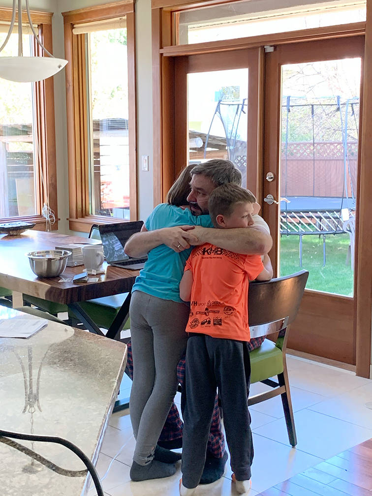"""Kristina Little took this photo of the moment her children first saw their father Rob after he returned home from hospital. """"It makes me cry almost every time I look at it,"""" she says."""