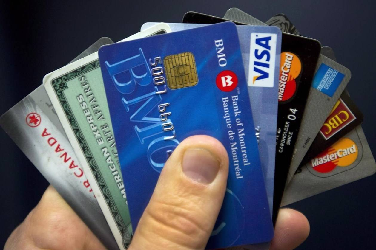 Credit cards are displayed in Montreal, Wednesday, Dec. 12, 2012. Equifax says the debt profile of Canadians has changed throughout the pandemic, with mortgages accounting for a larger portion of people's debt. THE CANADIAN PRESS/Ryan Remiorz