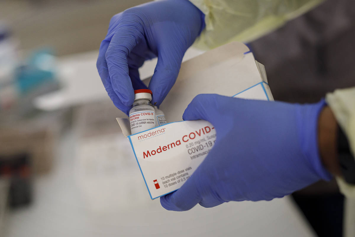 FILE – Healthcare workers from Women's College Hospital prepare doses of the Moderna COVID-19 vaccine at a pop-up vaccine clinic in Toronto on Saturday, April 17, 2021. THE CANADIAN PRESS/Cole Burston