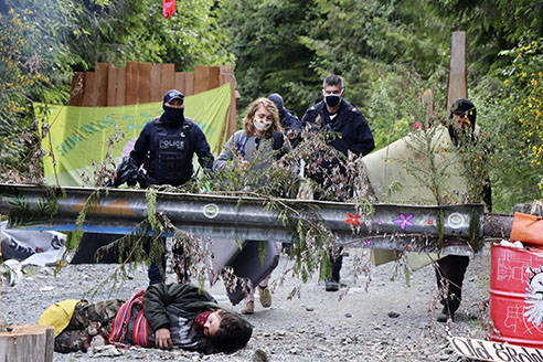 Police monitor protesters at a blockade in the Fairy Creek area of southwestern Vancouver Island on Wednesday, June 9. (Facebook photo)