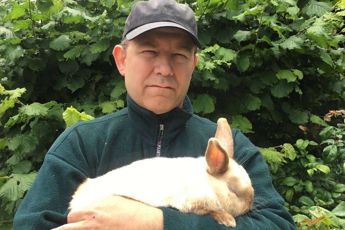 """Warren Brundage with """"Beans"""" the rabbit. (Submitted photo)"""