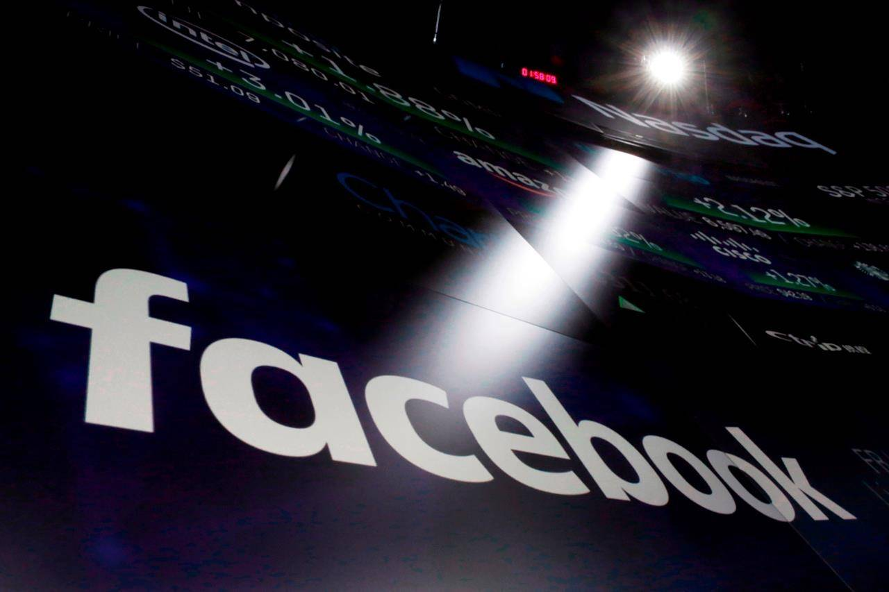 In this March 29, 2018, file photo, the logo for Facebook appears on screens at the Nasdaq MarketSite in New York's Times Square. Facebook was right to remove the profile of a man accused of killing four members of a Muslim family, experts say, but social media companies need to do more to fight hate on their planforms.THE CANADIAN PRESS/AP/Richard Drew