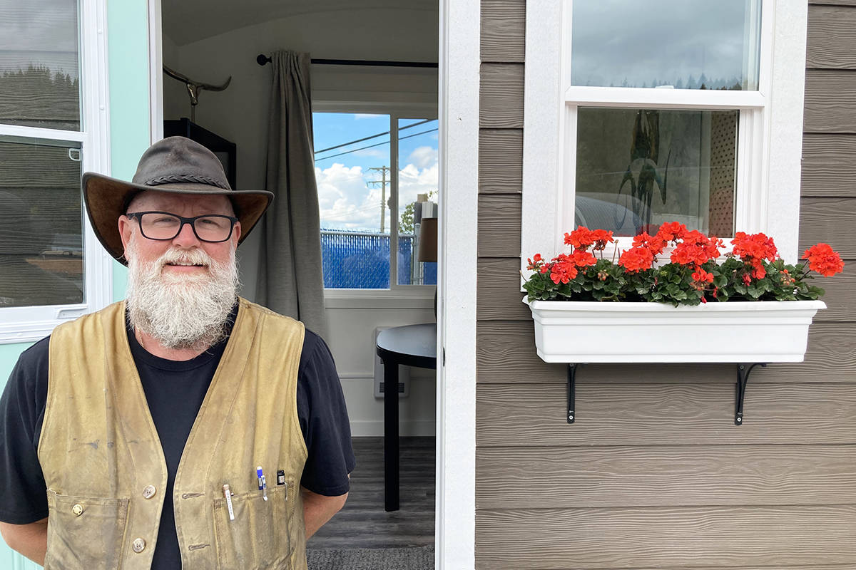 John Anjo, founder/ director of Dwelltech, poses in front of his newest creation. The YOCTO is a 72 square foot tiny home with all the fixings. (Ronan O'Doherty/ The News)