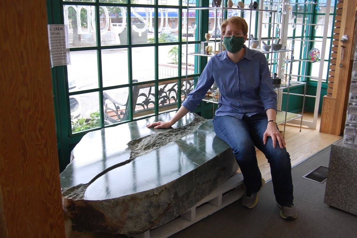 Heidi Roy of the Cariboo Jade Shop in Cache Creek with the 3,000 jade boulder, which is now on secure display inside the shop. (Photo credit: Barbara Roden)