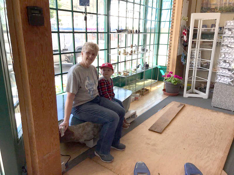 Judy Roy and her grandson Ben test the seating capacity of the jade boulder. (Photo credit: Heidi Roy)