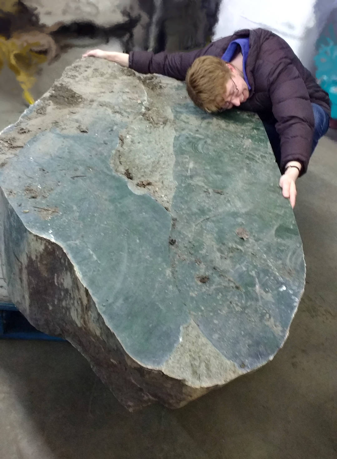 Heidi Roy of the Cariboo Jade Shop reunited with the jade boulder just after it was found. (Photo credit: Cariboo Jade Shop)