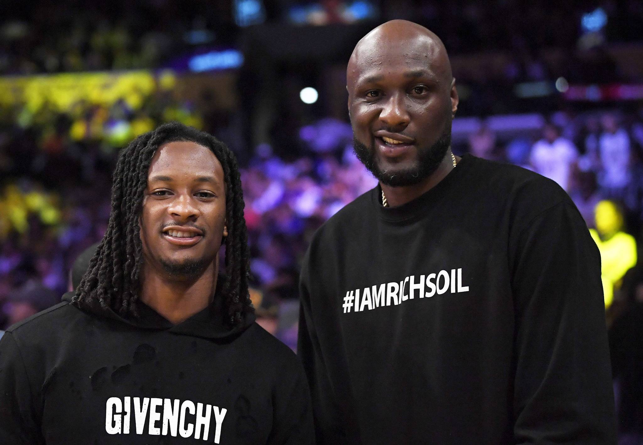 Los Angeles Rams running back Todd Gurley, left, poses with former NBA basketball player Lamar Odom during the second half of an NBA basketball game between the Los Angeles Lakers and the Cleveland Cavaliers, Sunday, March 11, 2018, in Los Angeles. The Lakers won 127-113. (AP Photo/Mark J. Terrill)