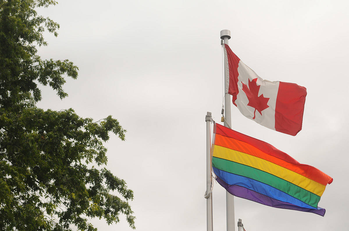 The rainbow flag flies beside the Canadian flag outside the University of the Fraser Valley's Chilliwack campus on June 26, 2020. Monday, June 14, 2021 is Flag Day, and also June is Pride Month. (Jenna Hauck/ Chilliwack Progress file)