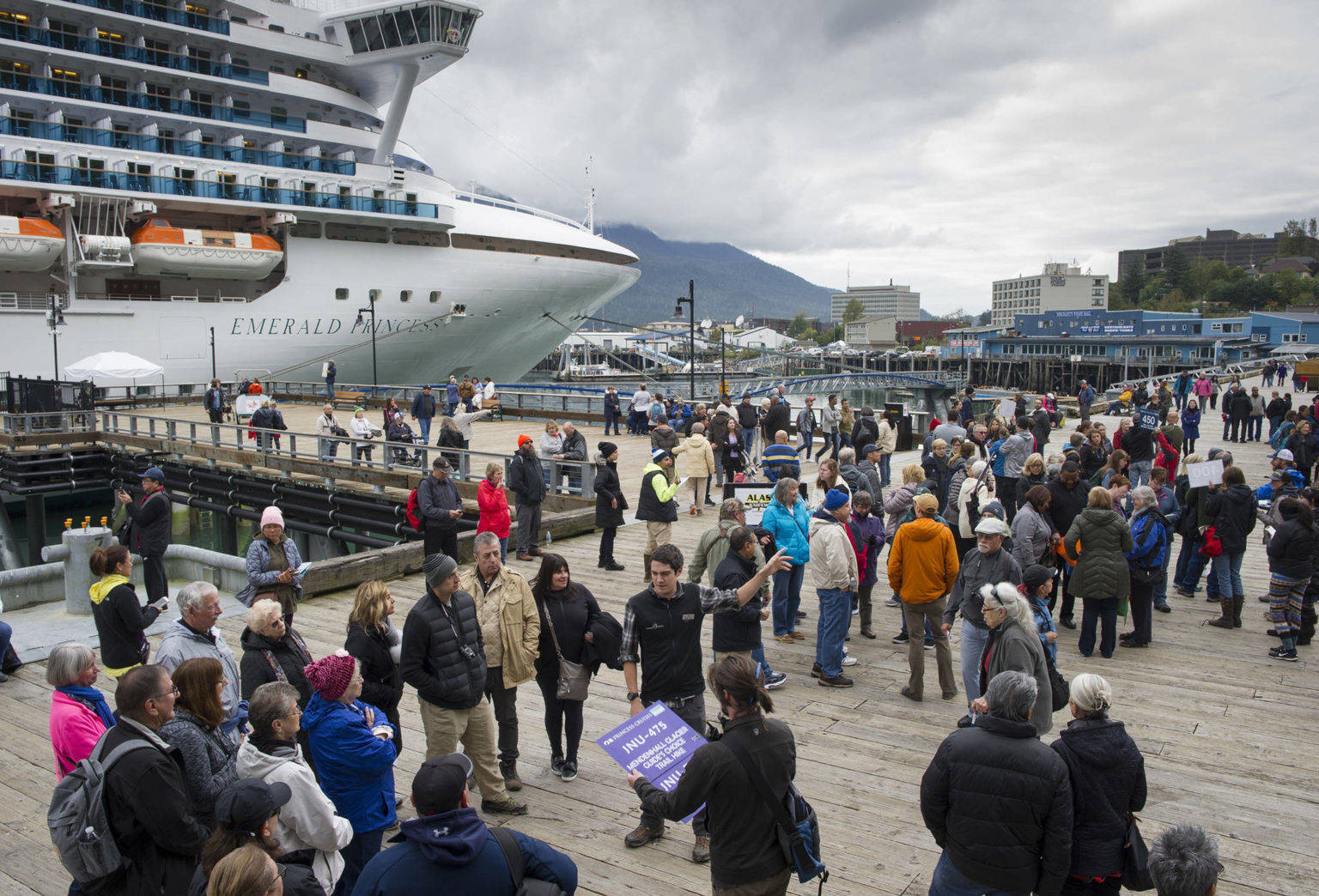 Cruise ship passengers arrive at Juneau, Alaska in 2018. Cruise lines have begun booking passengers for trips from Seattle to Alaska as early as this July, bypassing B.C. ports that are not allowed to have visitors until March 2022 under a Canadian COVID-19 restrictions. (Michael Penn/Juneau Empire)