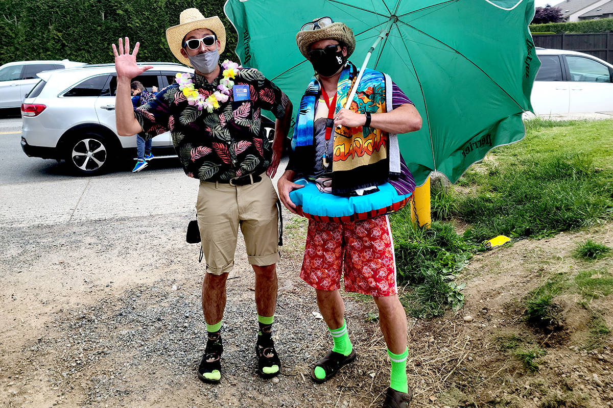 Principal Chris Wejr and vice principal Mark Touzeau of Shortreed Elementary got all dressed up for their students in a tacky tourist greeting on Friday morning. (Michelle Greer/Special to The Star)