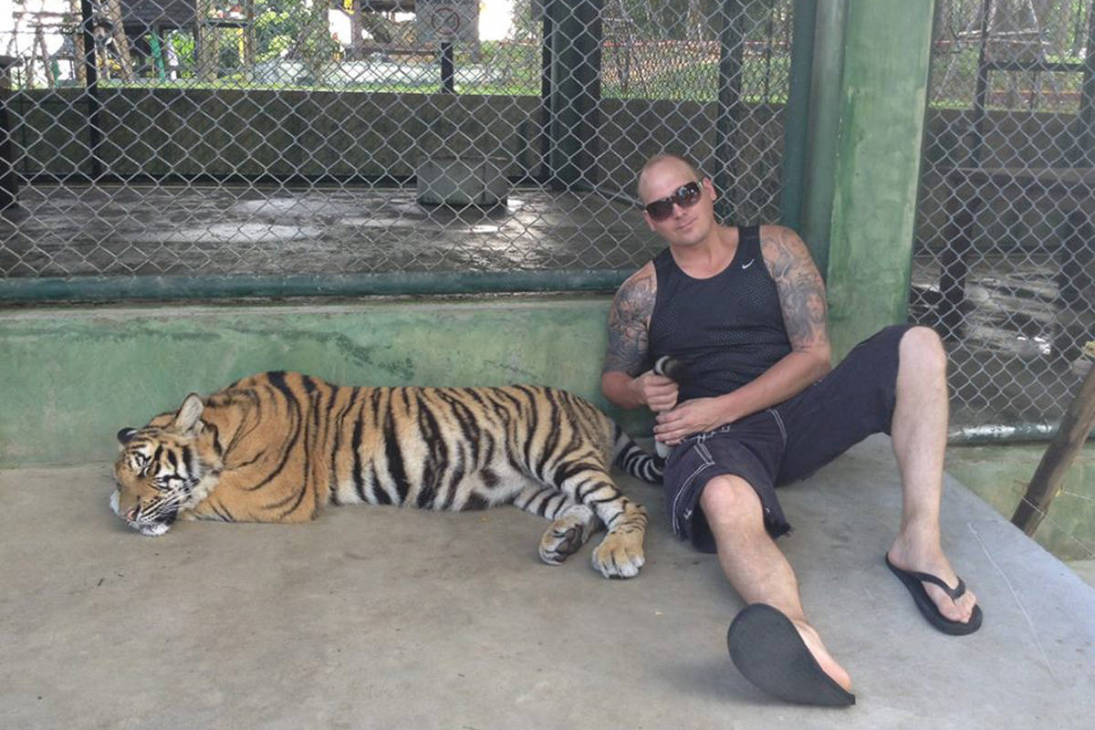 Chilliwack cocaine trafficker Clayton Eheler seen with a tiger somewhere in Asia in 2014. Eheler was sentenced to nine years jail in 2018, but was released on bail in October 2020 pending his appeal of conviction.(Facebook)