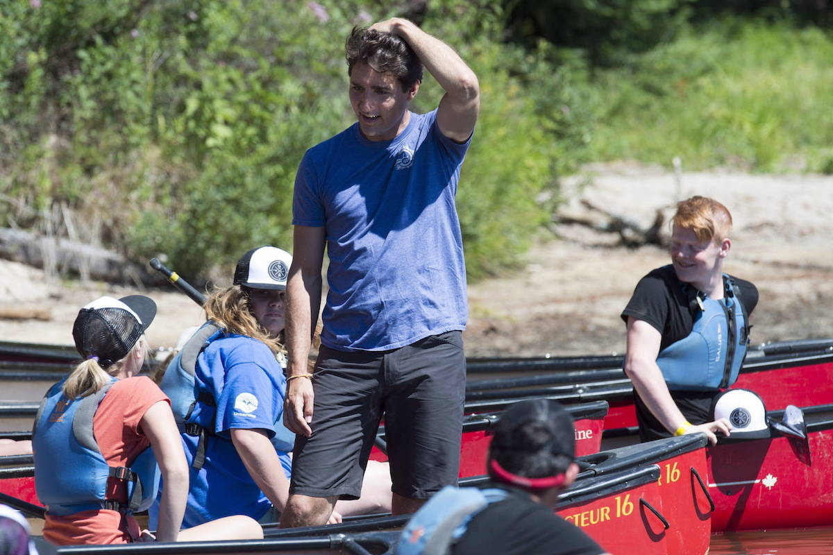 Prime Minister Justin Trudeau greets campers while visiting McDougall, Ont. on Thursday, July 19, 2018. THE CANADIAN PRESS/Frank Gunn