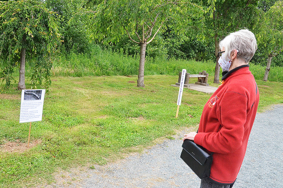 Marsha Miller walked through the Derek Doubleday Arboretum Friday afternoon, reading the info stations about residential schools and their impact on Indigenous Canadians. (Matthew Claxton/Langley Advance Times)