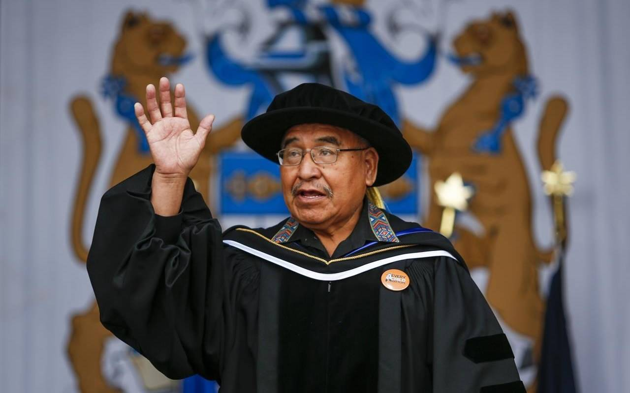 At an outdoor drive-in convocation ceremony, Mount Royal University bestows an honorary Doctor of Laws on Blackfoot Elder and residential school survivor Clarence Wolfleg in Calgary on Tuesday, June 8, 2021. THE CANADIAN PRESS/Jeff McIntosh