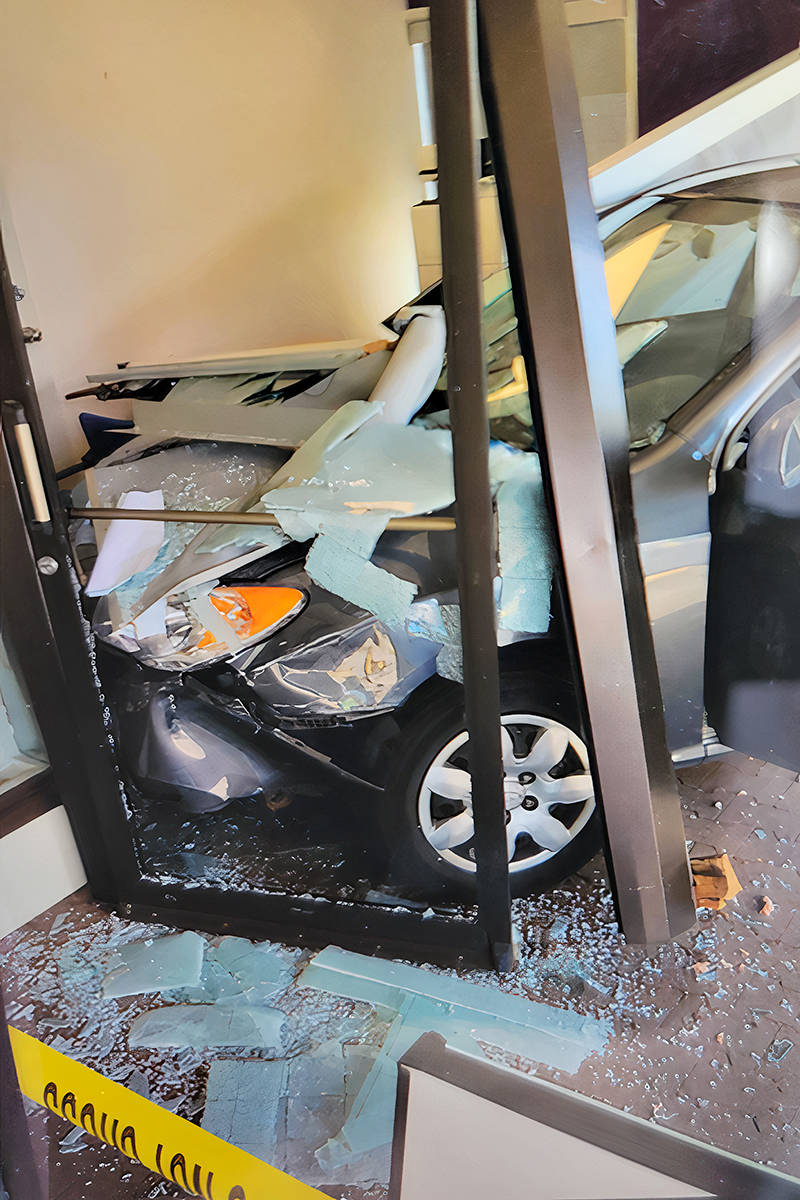 A car hit the window of a front office at Coast Capital Savings credit union in Brookswood 4145 - 200th Street on Saturday, June 12, after a driver apparently hopped a curb barrier. (Ron Peterse/Special to Langley Advance Times)