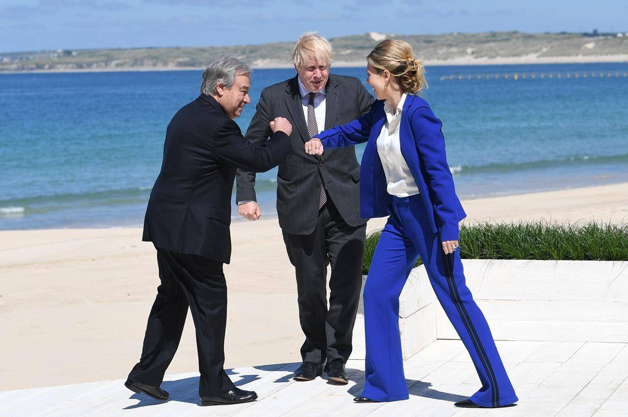 British Prime Minister Boris Johnson and his wife Carrie greet United Nations Secretary General Antonio Guterres, left, during arrivals for the G7 meeting in Carbis Bay, St. Ives, Cornwall, England, Saturday, June 12, 2021. Leaders of the G7 gathered for a second day of meetings on Saturday, in which they will discuss COVID-19, climate, foreign policy and the economy. (Stefan Rousseau/Pool via AP)