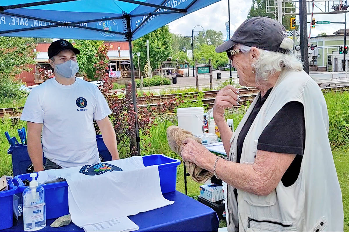 Bryan Miller of Your Local Community chats with volunteer Pam Arthur during a three-hour community cleanup that collected 400 lbs. of trash on Saturday, June 12. (Dan Ferguson/Langley Advance Times)