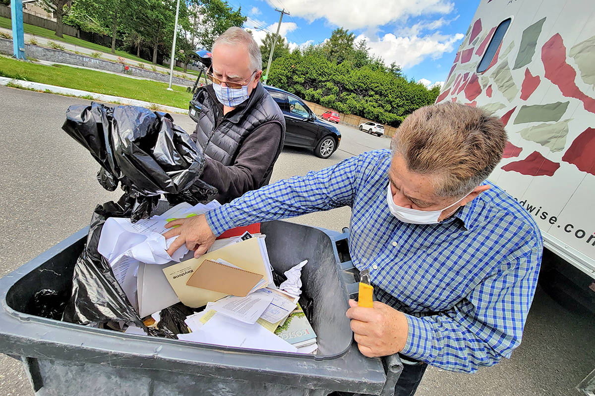 All Ecclestone (centre) drove in from South Surrey to dispose of 50 years' worth of tax returns at the annual shredathon fundraiser operated by the Aldergrove Fair Society at the Legion branch on Fraser Highway on Saturday, June 13. (Dan Ferguson/Langley Advance Times)