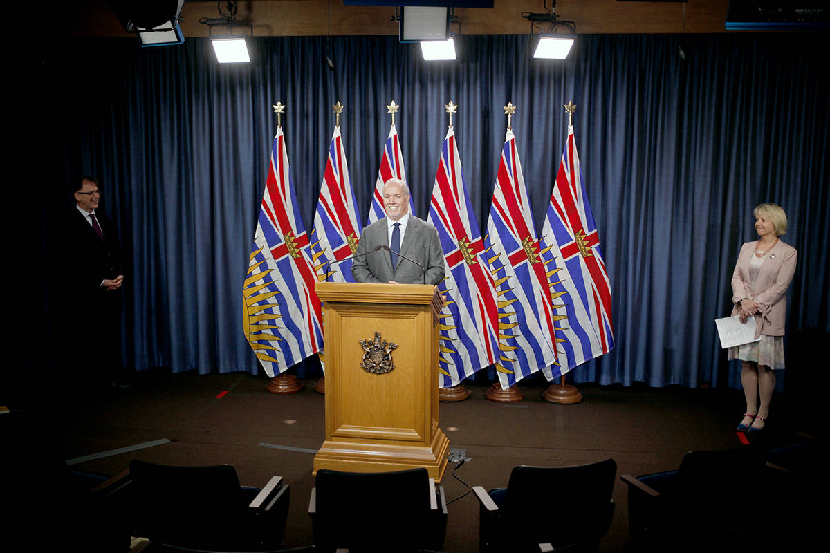 Premier John Horgan speaks as provincial health officer Dr. Bonnie Henry, right, and health minister Adrian Dix look on during a press conference to update on the province's fall pandemic preparedness plan during a press conference from the press theatre at Legislature in Victoria, Wednesday, Sept. 9, 2020. THE CANADIAN PRESS/Chad Hipolito