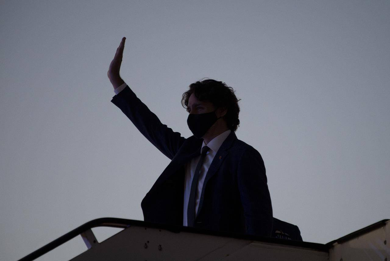Canadian Prime Minister Justin Trudeau waves as he arrives in Brussels, Belgium, Sunday, June 13, 2021. The Prime Minister is in Brussels today for a meeting of the North Atlantic Treaty Organization and then a Canada-EU summit. THE CANADIAN PRESS/Adrian Wyld