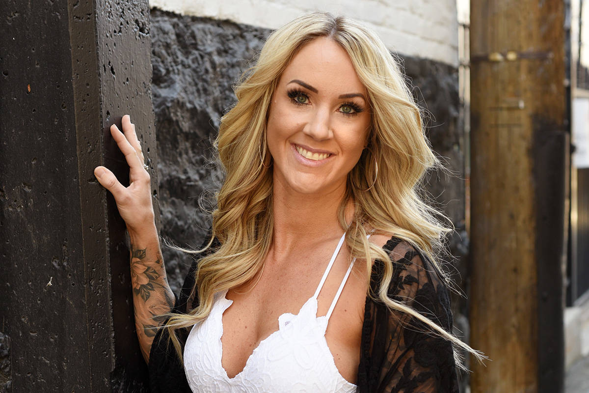 Lindsay Holt shows off her tattoos for a Secrets and Lives interview for Boulevard Vancouver. Don Denton photograph