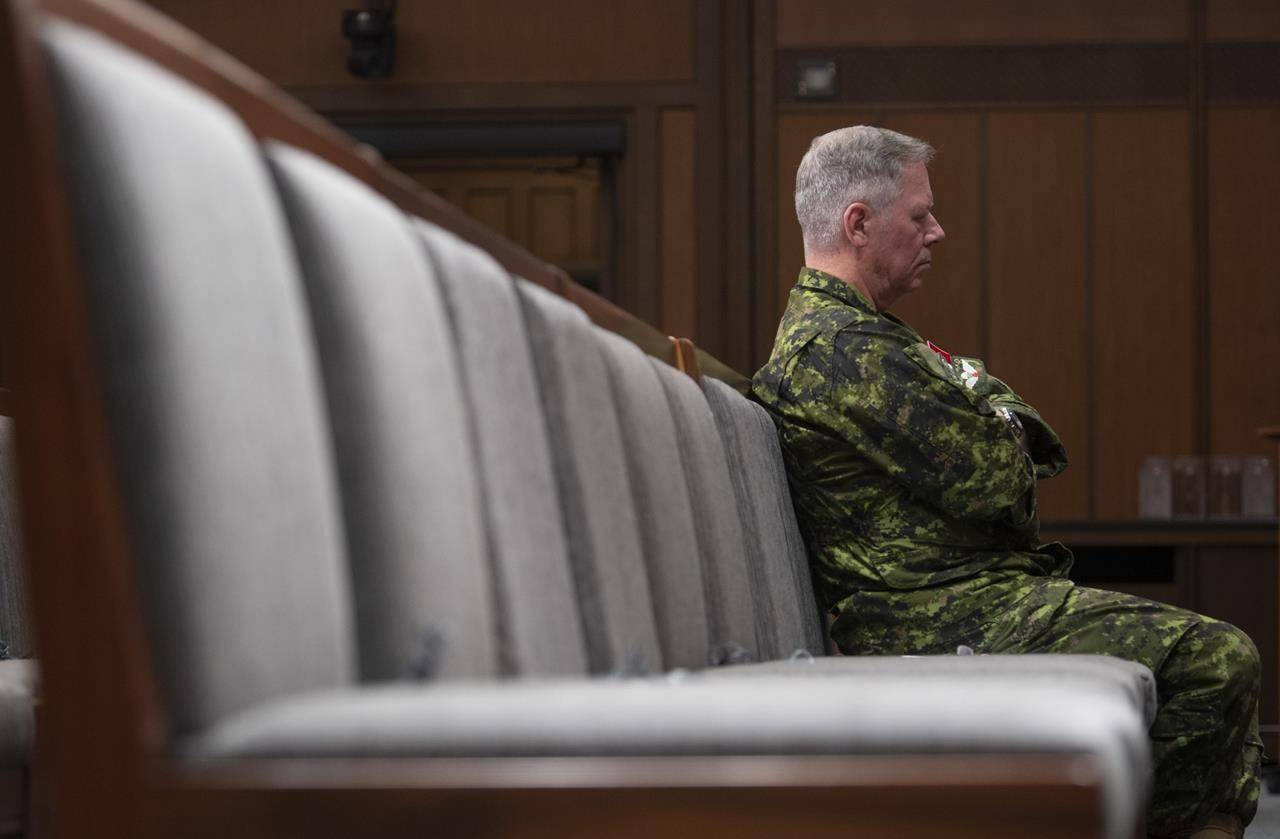 Chief of Defence Staff Jonathan Vance sits in the front row during a news conference Friday, June 26, 2020 in Ottawa. THE CANADIAN PRESS/Adrian Wyld