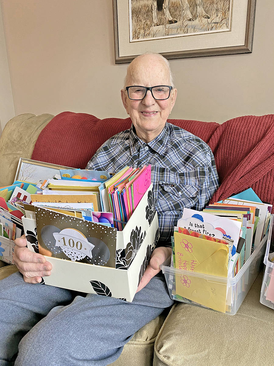 John Kromhoff with some of the many birthday cards he received from 'pretty near every place in the world' after the family of the Langley centenarian let it be known that he wasn't expecting many cards for his 100th birthday. (Special to Langley Advance Times)