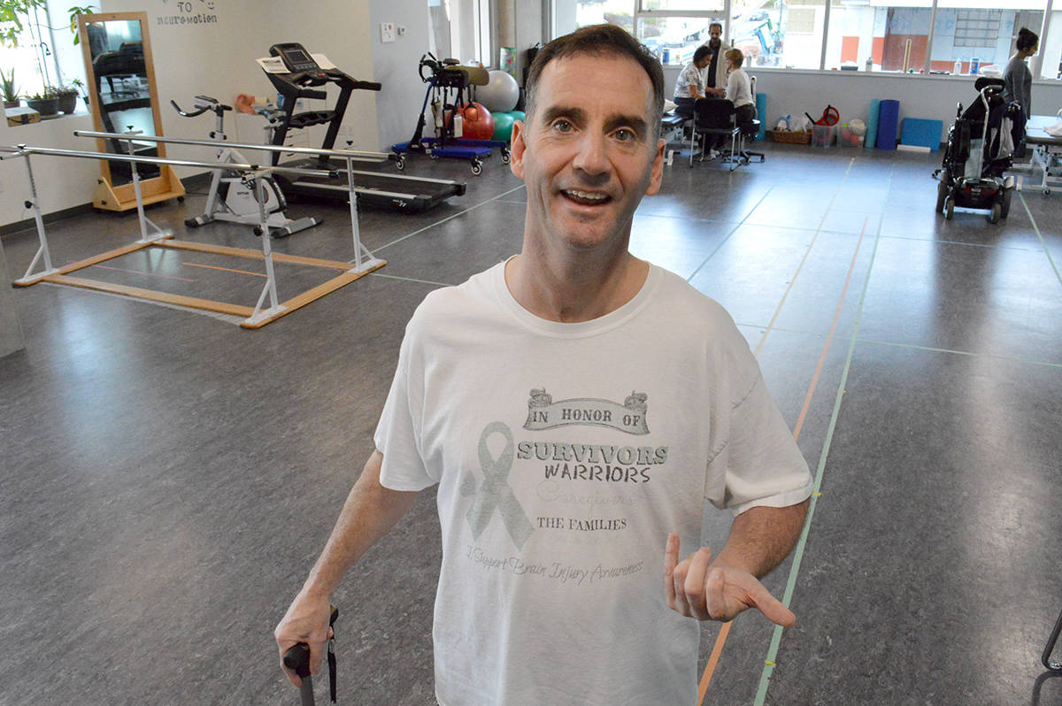 Michael Coss, a brain injury survivor who lives in Langley – seen here in a 2017 photo undergoing physical therapy – has organized a cross-country video conference of fellow survivors for brain injury awareness month in Canada. (Black Press media file)