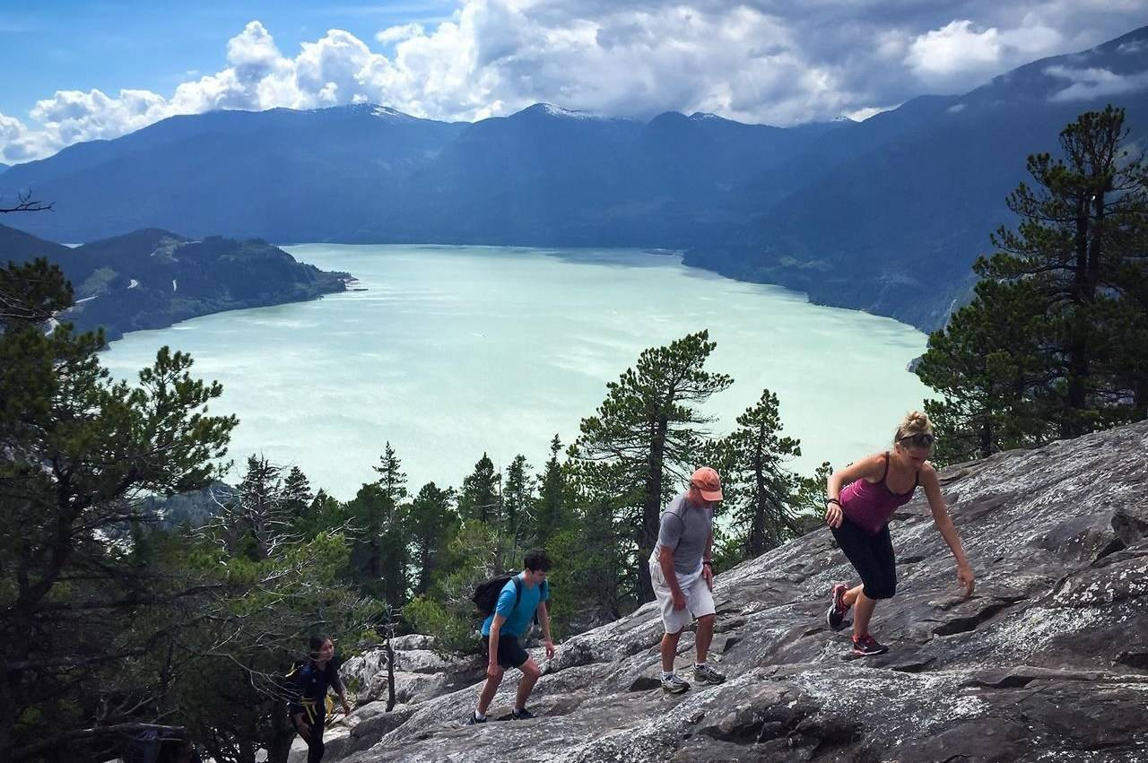 People climb up a rock face towards the first peak on the Stawamus Chief mountain above the waters of Howe Sound in Squamish, B.C., on Saturday, July 2, 2016. THE CANADIAN PRESS/Darryl Dyck