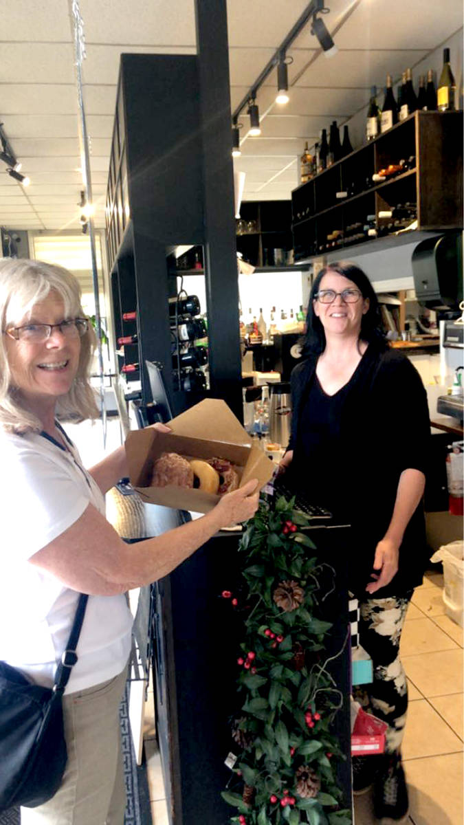 ABA member Karen Long purchases fresh Donuts at Brick Alley Bistro. (Special to The Star)