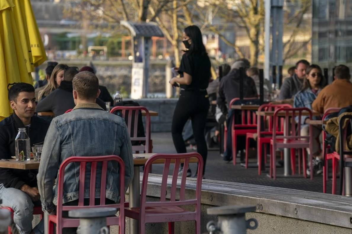 Restaurant patrons enjoy the weather on a patio in Vancouver, B.C., on April 5, 2021. THE CANADIAN PRESS/Jonathan Hayward